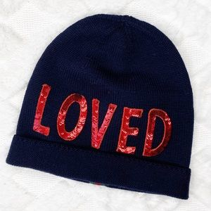 """GUCCI knit """"LOVED"""" beanie."""